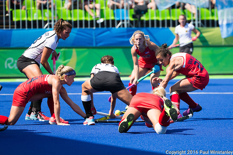 Kathleen Sharkey #24 of United States, Caitlin van Sickle #28 of United States and Kelsey Kolojejchick #7 of United States fight for the ball in the goalmouth during USA vs Germany in a women's quarterfinal game at the Rio 2016 Olympics at the Olympic Hockey Centre in Rio de Janeiro, Brazil.