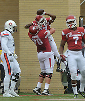 NWA Democrat-Gazette/MICHAEL WOODS • @NWAMICHAELW<br /> University of Arkansas receiver Dominique Reed celebrates with teammate Dan Skipper after scoring a touchdown in the 1st quarter of the Razorbacks 54-46 win over Auburn during Saturdays game at Razorback Stadium in Fayetteville.