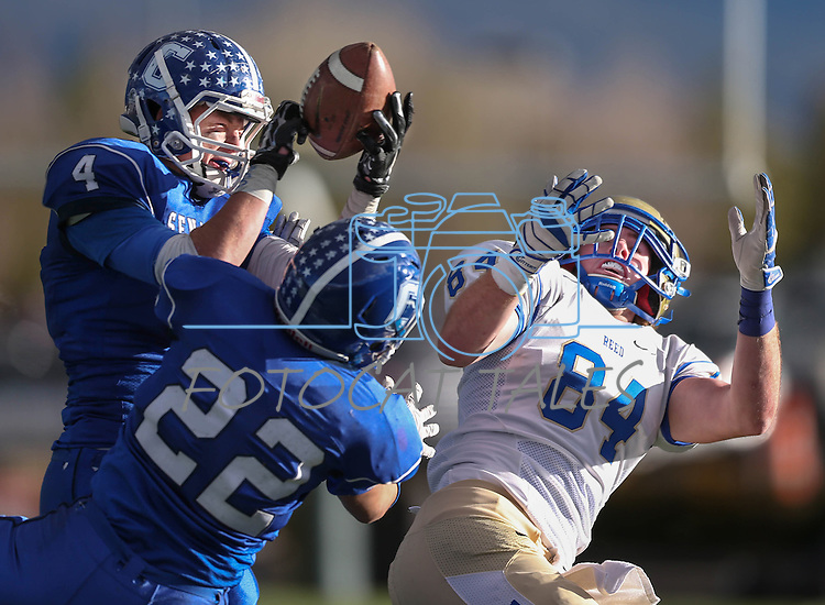 Carson's Asa Carter makes an interception against Reed's Parker Houston during the NIAA D-1 Northern Regional title game at Bishop Manogue High School in Reno, Nev., on Saturday, Nov. 29, 2014. Reed won 28-25.<br /> Photo by Cathleen Allison