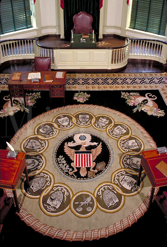 Balcony view shows insignia, carpet, desks and speaker table of Senate Chamber in Congress Hall. Independence National Historical Park. Philadelphia Pennsylvania United States.