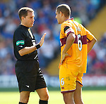 Referee Dougie McDonald has words with Giles Coke after Pedro Mendes landed in a heap