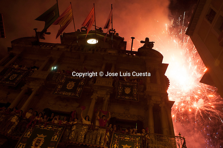 "Fireworks during the ""Pobre de mi"" traditional song on the last day of Sanfermines and means the end of the festival in city hall square, Pamplona, northern of Spain. San Fermin festival is worldwide known because the daily running bulls."