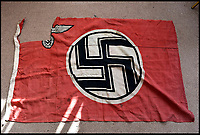 BNPS.co.uk (01202 558833)<br /> Pic: SAS/BNPS<br /> <br /> Adolf Hitler's personal standard that was flown on his luxurious yacht until it was seized by a souvenier-hunting Royal Navy seaman has emerged for sale.<br /> <br /> Signalman Jack Lee removed the highly sought-after Nazi swastika flag after the vessel, called the Grille, was taken over by the navy at the end of the Second World War.<br /> <br /> SM Lee found the 39ins by 67ins red and black flag that had been hidden on board by the German crew.<br /> <br /> Accompanying the flag is a remarkable letter from his describing the luxurious surroundings if thee 443ft long yacht.