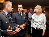 London, England, 2 July 2011, Pride London 2011 celebrations in Central London. Home Secretary Theresa May in conversation with members of the Armed Forces at the Langham Hotel. Photo credit: Bettina Strenske
