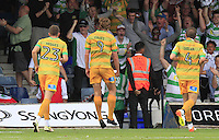 Tom Eaves of Yeovil Town (Centre) celebrates his equalizing goal during the Sky Bet League 2 match between Luton Town and Yeovil Town at Kenilworth Road, Luton, England on 13 August 2016. Photo by Liam Smith.