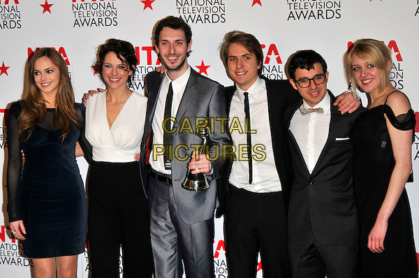 HANNAH TOINTON, BELINDA STEWART-WILSON , BLAKE HARRISON, JOE THOMAS, SIMON BIRD & EMILY HEAD of 'The Inbetweeners'.Attending the National Television Awards at O2 Arena, London, England..January 26th, 2011.NTA NTAs press room winners trophy grey gray blue dress suit navy velvet glasses bow tie tuxedo tux suit cast .CAP/PL.©Phil Loftus/Capital Pictures.