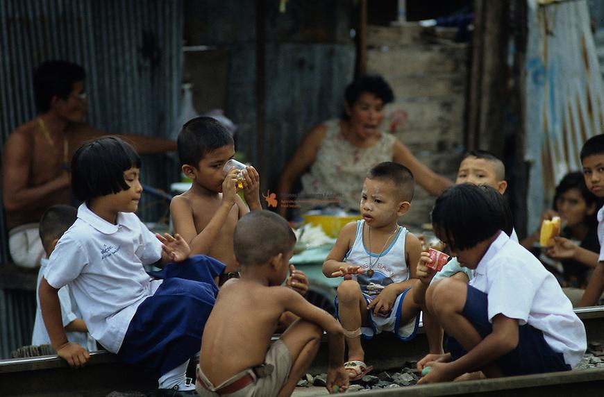 Thai Children having a drink along the road