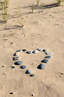 A heart shape made of Lake Superior stones found on a beach in Pictured Rocks National Lakeshore - Grand Marais, MI