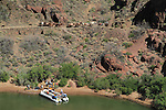A pack mule train and a whitewater raft along the Colorado River at Phantom Ranch Campground, Grand Canyon National Park, northern Arizona, USA . John offers private photo tours in Grand Canyon National Park and throughout Arizona, Utah and Colorado. Year-round.