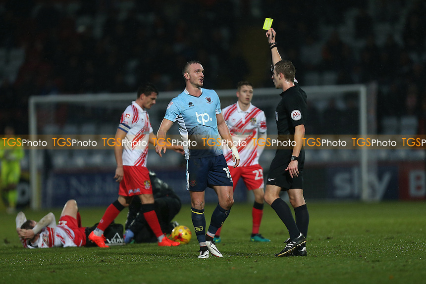 Tom Aldred of Blackpool is shown a yellow card during Stevenage vs Blackpool, Sky Bet EFL League 2 Football at the Lamex Stadium on 10th December 2016