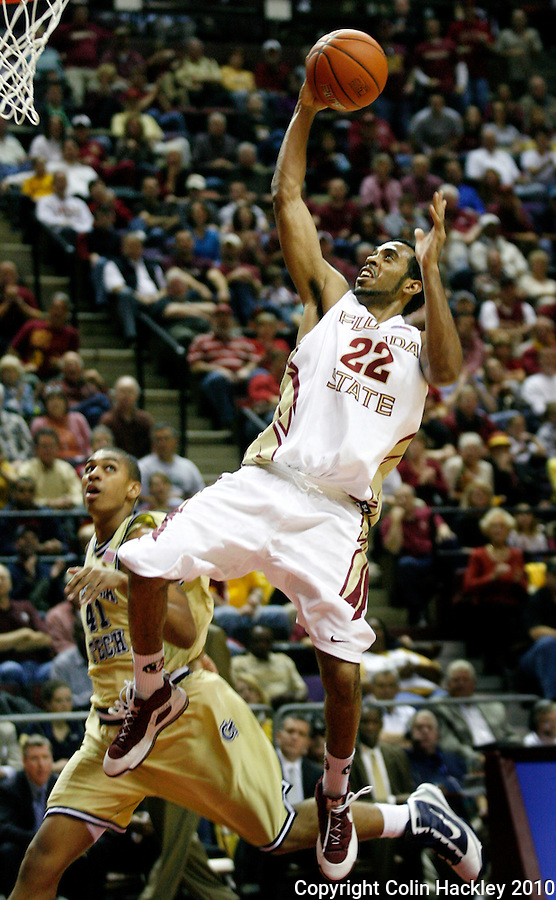 TALLAHASSEE, FL 1/24/10-FSU-GA. TECH MBB10 CH14-Florida State's Derwin Kitchen flies by Georgia Tech's Glen Rice Jr. during first half action Sunday at the Donald L. Tucker Center in Tallahassee...COLIN HACKLEY PHOTO