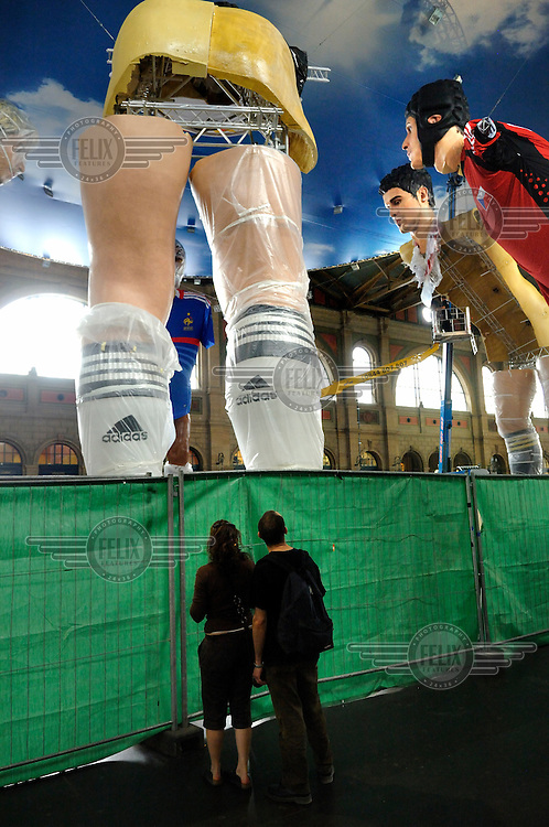 Giant figures of football stars being put up in the main concourse of Zurich Railway Station, in the build up to the Euro 2008 competition held partly in Switzerland.