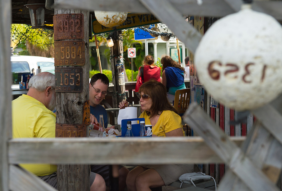 KEY WEST, FL - CIRCA 2012: Patrons on famous Bo's Fish Wagon  a landmark in Key West circa 2012. The tropical city is a popular tourist destination with over 2 million yearly visitors.