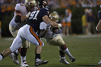 24 September 2005:  Virginia's Chris Long (91) fights off a block by Florida State's Cory Niblock (62) and tackles RB Leon Washington (3).  The Virginia Cavaliers upset the #4 Florida State Seminoles 26-21 at Scott Stadium in Charlottesville, VA.