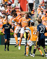 Houston Dynamo midfielder Brad Davis (11), Houston Dynamo midfielder Stuart Holden (22) , and Los Angeles Galaxy midfielder Dema Kovalenko (8) go up for the header. Houston Dynamo tied Los Angeles Galaxy 0-0 at Robertson Stadium in Houston, TX on October 18, 2009.
