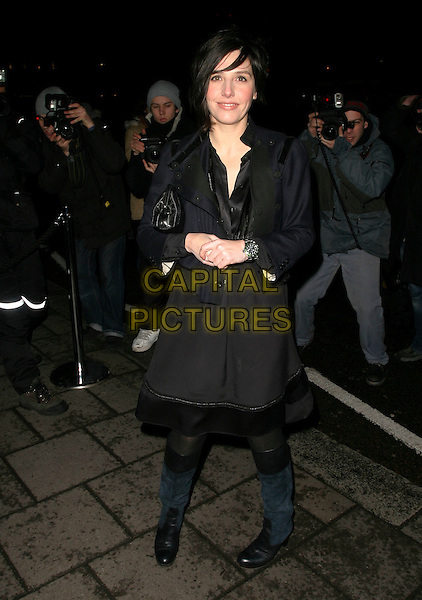 SHARLEEN SPITERI.Finch & Partners' Pre-BAFTA Party, Annabel's, Berkeley Square, London, England, .February 18th 2006..full length black coat.Ref : AH.www.capitalpictures.com.sales@capitalpictures.com.©Adam Houghton/Capital Pictures.