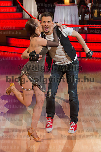 Gabi Toth and Robert Marko dance in the live broadcast celebrity dancing talent show Saturday Night Fever by Hungarian television company RTL II in Budapest, Hungary on March 16, 2013. ATTILA VOLGYI