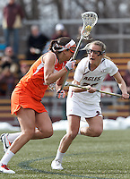 Syracuse University attacker Alyssa Murray (1) on the attack as Boston College midfielder Kate McCarthy (20) defends.  Syracuse University (orange) defeated Boston College (white), 17-12, on the Newton Campus Lacrosse Field at Boston College, on March 27, 2013.