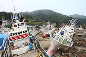 June 13, 2011; Kesennuma, Miyagi Pref., Japan - Fishing boats lie scattered like toys on dry land a quarter-mile from the ocean after a tsunami carried them inland after the magnitude 9.0 Great East Japan Earthquake and Tsunami that devastated the Tohoku region of Japan on March 11, 2011.