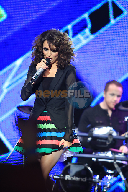Cher Lloyd performs at the 2011 Cheerios Childline Concert in the O2...(Photo credit should read Jenny Matthews www.newsfile.ie)....This Picture has been sent you under the conditions enclosed by:.Newsfile Ltd..The Studio,.Millmount Abbey,.Drogheda,.Co Meath..Ireland..Tel: +353(0)41-9871240.Fax: +353(0)41-9871260.GSM: +353(0)86-2500958.email: pictures@newsfile.ie.www.newsfile.ie.