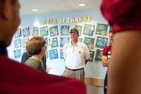 MIAMI, FL--Coach Jim Harbaugh shares a laugh with hospital administrators before visiting with patients at Baptist Children's Hospital in Miami, Florida.