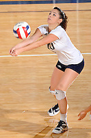 24 September 2010:  FIU's Rachel Fernandez (5) returns a serve in the second set as the FIU Golden Panthers defeated the University of Denver Pioneers, 3-0 (29-27, 25-16, 25-20), at U.S Century Bank Arena in Miami, Florida.