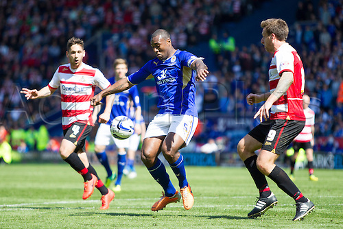 03.05.2014.  Leicester, England. Wes MORGAN (Leicester City) controls the ball under pressure during the FA Championship match between Leicester City and Doncaster Rovers at The King Power Stadium.