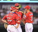 (L-R) Chris Gimenez, Yu Darvish, Mike Maddux (Rangers),<br /> JULY 9, 2014 - MLB :<br /> Pitcher Yu Darvish of the Texas Rangers talks with pitching coach Mike Maddux and catcher Chris Gimenez in the sixth inning during the Major League Baseball game against the Houston Astros at Globe Life Park in Arlington in Arlington, Texas, United States. (Photo by AFLO)