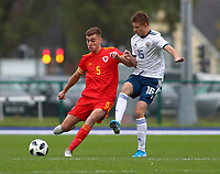 16th November 2019; Leckwith Stadium, Cardiff, Glamorgan, Wales; European Championship Under 19 2020 Qualifiers, Russia under 19s versus Wales under 19s; Ryan Astley of Wales Under 19 clears the ball as Kirill Kosarev of Russia Under 19 closes in - Editorial Use