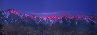 902000033 panoramic view of dawn alpenglow lighting up mount whitney and the eastern sierras mountain rainge seen from the alabama hills near lone pine in kern county california