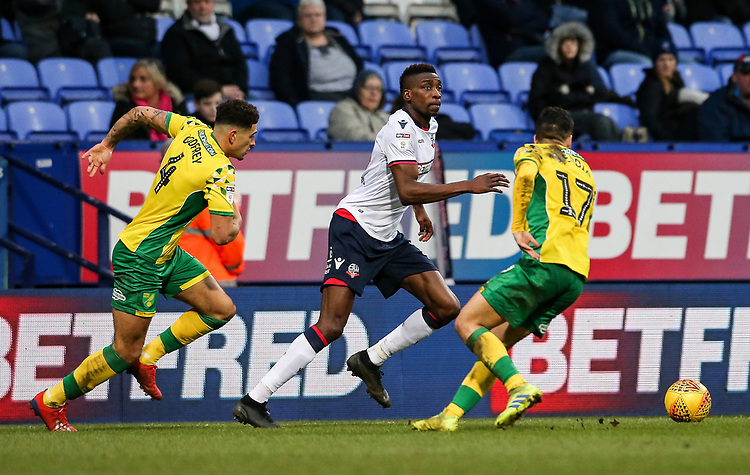 Bolton Wanderers' Sammy Ameobi checks his options under pressure from  Norwich City's Ben Godfrey and Emi Buendia<br /> <br /> Photographer Andrew Kearns/CameraSport<br /> <br /> The EFL Sky Bet Championship - Bolton Wanderers v Norwich City - Saturday 16th February 2019 - University of Bolton Stadium - Bolton<br /> <br /> World Copyright © 2019 CameraSport. All rights reserved. 43 Linden Ave. Countesthorpe. Leicester. England. LE8 5PG - Tel: +44 (0) 116 277 4147 - admin@camerasport.com - www.camerasport.com