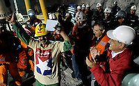 Chile President Sebastian Piñera embraces miner rescued Juan Illanes. Rescue in San Jose mine, north of Chile