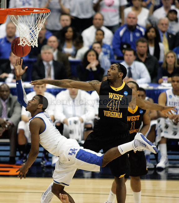 Freshman guard John Wall moves past John Flowers to make a lay up in the second half of UK's Elite 8 loss , 73-66, against West Virginia at the Carrier Dome in Syracuse, NY on  Saturday, March 27, 2010. Photo by Britney McIntosh | Staff