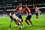 Atletico de Madrid's Filipe Luis (L) and Lucas Hernandez  (R)and SD Huesca's Luis Ezequiel 'Chimy' Avila during La Liga match between Atletico de Madrid and SD Huesca at Wanda Metropolitano Stadium in Madrid, Spain. September 25, 2018. (ALTERPHOTOS/A. Perez Meca)