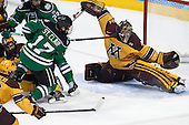 Gabe Guertler (MN - 27), Andrew Panzarella (North Dakota - 22), Colten St. Clair (North Dakota - 17), Adam Wilcox (MN - 32) - The University of Minnesota Golden Gophers defeated the University of North Dakota 2-1 on Thursday, April 10, 2014, at the Wells Fargo Center in Philadelphia to advance to the Frozen Four final.