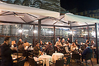 Tavolini all'aperto all'esterno di un bar in con vista sul Duomo di Firenze.<br /> Outdoor cafes at night past Florence's Duomo.<br /> UPDATE IMAGES PRESS/Riccardo De Luca