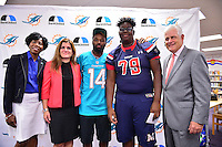 MIAMI, FL - SEPTEMBER 20: BankUnited Vice President of Community Development & Outreach Katrina Wright, Miramar High School Principal Maria Formoso, Miami Dolphins Wide Receiver (#14) Jarvis Landry, Stephen Gordon and BankUnited Senior Executive Vice President Gerry Litrento surprise the Miramar Patriots varsity football team prior to the teamís practice as part of the 4 Downs for Finance financial literacy program sponsored by BankUnited. Landry share his thoughts on the importance of financial literacy at Miramar High School Media Center on September 20, 2016 in Miramar, Florida. Credit: MPI10 / MediaPunch