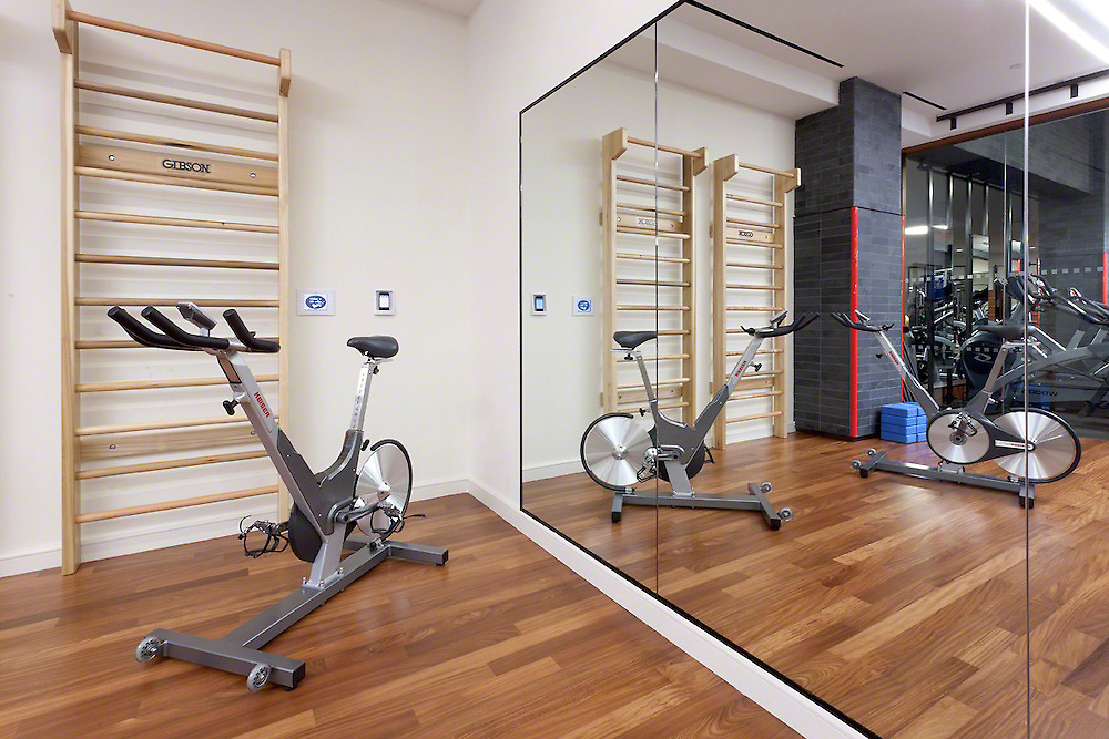 Exercise Room With Large Mirror