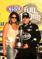 Mar. 13, 2011; Gainesville, FL, USA; NHRA top fuel dragster driver Del Worsham and wife Connie Worsham at the winners circle celebration during the Gatornationals at Gainesville Raceway. Mandatory Credit: Mark J. Rebilas-