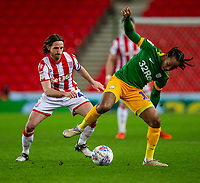 12th February 2020; Bet365 Stadium, Stoke, Staffordshire, England; English Championship Football, Stoke City versus Preston North End; Joe Allen of Stoke City tackles Daniel Johnson of Preston North End