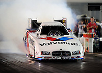 Sept. 17, 2010; Concord, NC, USA; NHRA funny car driver Jack Beckman does a burnout during qualifying for the O'Reilly Auto Parts NHRA Nationals at zMax Dragway. Mandatory Credit: Mark J. Rebilas/