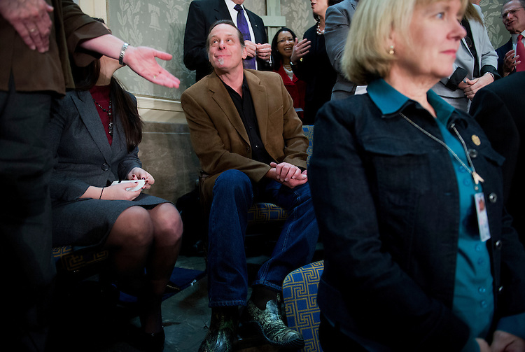 UNITED STATES - FEBRUARY 12:  Musician Ted Nugent, who was a guest of Rep. Steve Stockman, R-Texas, talks with guests in the House gallery before President Barack Obama delivered his State of the Union address to Congress. (Photo By Tom Williams/CQ Roll Call)