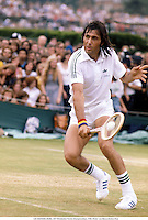 ILIE NASTASE (ROM), 1977 Wimbledon Tennis Championships, 7706. Photo: Leo Mason/Action Plus...1977.man