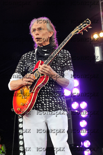 Asia - guitarist Steve Howe - performing live on Day One on the Prog Stage at the High Voltage Festival in London UK - 24 Jul 2010.  Photo credit: George Chin/IconicPix