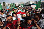 Palestinian mourners carry the body of Nasser al-Arini, 28, who died of his wounds endured during clashes with Israeli troops in a tent city protest where Palestinians demand the right to return to their homeland at the Israel-Gaza border, during his funeral in Jabalia in the northern of Gaza Strip, on May 28, 2018. Photo by Mahmoud Ajour