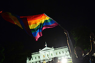 Washington, DC - June 12, 2016: A man waves the LGBT flag during a vigil in front of the White House, June 12, 2016, to show support for the victims of the mass shooting at a nightclub in Orlando, Florida. The shooting was the deadliest in U.S. history, with 50 fatalities and 53 casualties.  (Photo by Don Baxter/Media Images International)