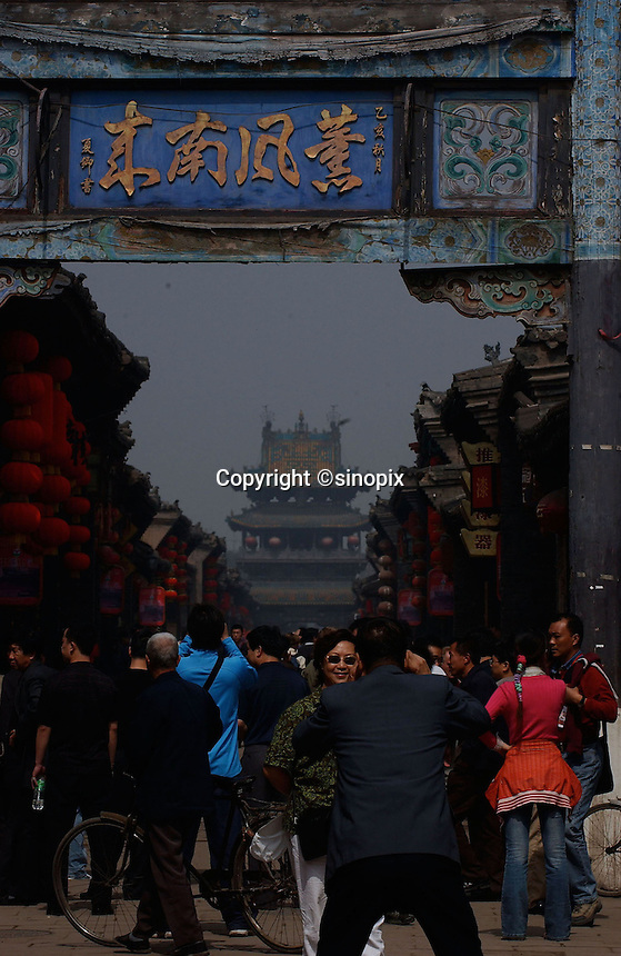 General street scene of Pingyao in Shannxi, one of the last cities in China that retains traditional Chinese architecture..19-SEP-04