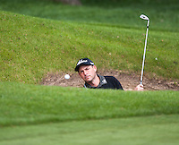 19.05.2015. Wentworth, England. BMW PGA Golf Championship. Practice Day. David Howell plays out of the bunker at 18th hole during the practice round of the 2015 BMW PGA Championship from The West Course Wentworth Golf Club