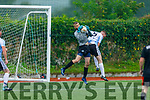 CS Clochain Breannainn keeper Luke Mulally gathers under pressure from Kieran Griffin of Castlemaine Utd in the Denny Division 1B League Final