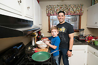 Military dad and son cooking in the kitchen